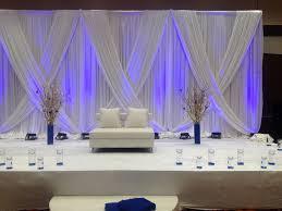 wedding backdrop linen blue accents make a powerful splash against an all white linen