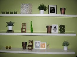 white wall mounted shelving unit for knick knacks collection and