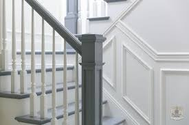 Spindle Staircase Ideas White And Gray Staircase Boasts A Gray Handrail And Steps As Well