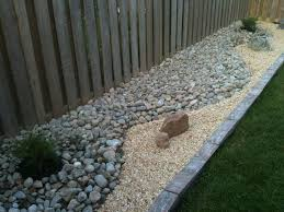 use gravel pebbles and bark chips for practical versatile garden