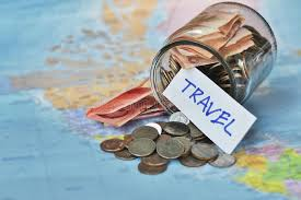Travel budget concept travel money savings in a glass jar stock