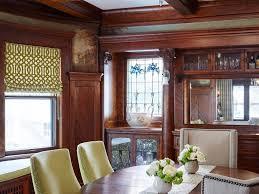 wood slab table sunken dining room concrete flooring columns