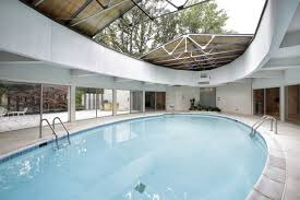 home pool suburban keck u0026 keck home with central pool retractable roof