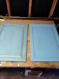 painting kitchen cabinets with annie sloan chalk paint the door on the right has two coats of paint the door on the left