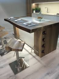 modern kitchen island ideas that reinvent a classic wood contertop kitchen island and wine bottle storage