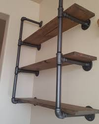industrial pipe shelving with reclaimed wood this unit has three