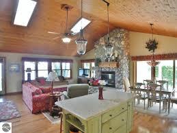 rustic great room with flush light skylight in cedar mi