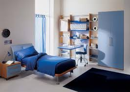 boy bedroom ideas blue wall white wallmount shelves high bookcase bedroom boy bedroom ideas light blue armoire dark blue rug thick comforter thick bed cover