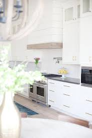 white kitchen cabinets with lewis dolin brass bar pulls