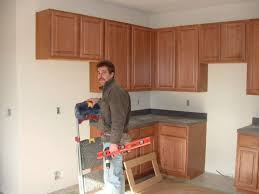 kitchen cabinets sarasota sarasota cabinet install use a stud finder to locate the wall how
