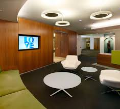 conference table with recessed monitors reception area walnut wall recessed monitor and lounge seating l