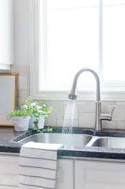 new kitchen faucet easy kitchen upgrade our new kitchen faucet a burst of beautiful