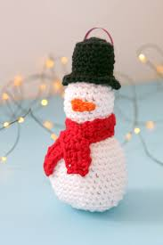 Amigurumi Christmas Ornaments - amigurumi snowman ornament hands occupied