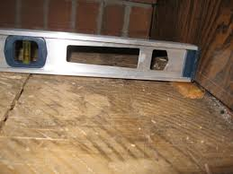 level a subfloor with sagging joist for hardwood floor building