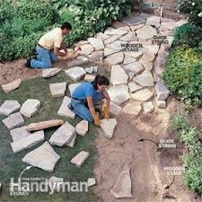 How To Make A Rock Patio by How To Make A Path Of Building For A Stone Path Family Handyman
