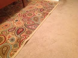 Stop Area Rug From Sliding On Carpet How To Keep Area Rug On Carpet Flat