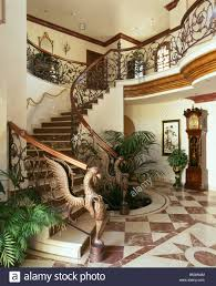 ornate wrought iron bannisteers on curved staircase in spanish