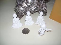 set of 3 mini thai style buddha ornaments mini cherub holding