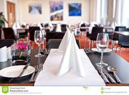 tables with formal setup in modern restaurant royalty free stock