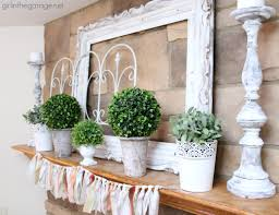 white and green spring mantel in the garage