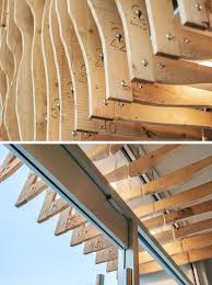 this building is covered in fins made from 100 year old reclaimed