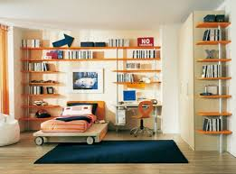 sunny bedroom for kids with orange wall book storage beige wall