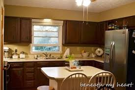 How To Paint Kitchen Cabinet Painting Our Kitchen Cabinets Supplies And Process Beneath My