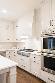 wall tiles for white kitchen cabinets white kitchen cabinets with white glass backsplash tiles