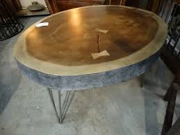 Slab Coffee Table by This Coffee Table Has Three Metal Hairpin Legs And Bowtie Inlay