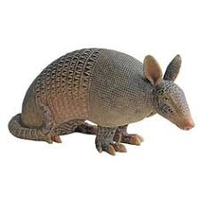 this unique collectible dangly armadillo ornament will look right