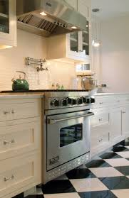 great black and white tiled kitchen on kitchen with black white
