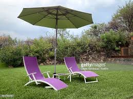 Patio Umbrella Table And Chairs Patio Umbrella Stock Photos And Pictures Getty Images