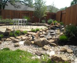 stunning rock garden design with colorful plants and flowers in a