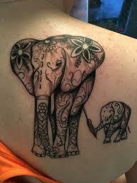 cartoon couple tattoos elephant tattoo on shoulder blade tattoos pinterest elephant
