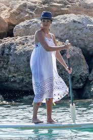 alba paddleboards during family vacation in hawaii daily
