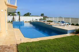 modern pool with vanishing edge cube spa all aqua pools linear pool with raised deck area