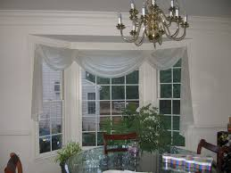 window treatments for bay windows in dining rooms triple bay window w scarf treatment ideas for home makeovers