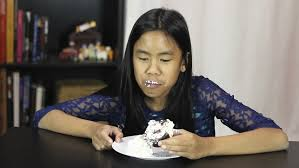 hesitant fat woman eats a cake guilt diet fitness health care