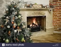 christmas tree next to burning fireplace vintage style interior