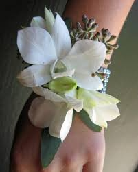 white orchid corsage blue white and black wedding flowers in laguna white
