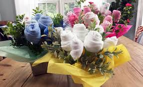 the sweetest diy baby shower gift u2014a washcloth and onesie bouquet
