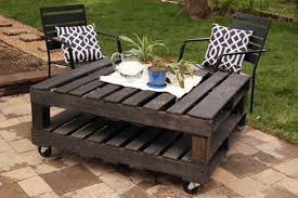 furnitures small patio with creative dark pallet wood table on