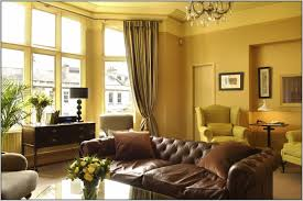 color picture living room paint ideas with brown furniture