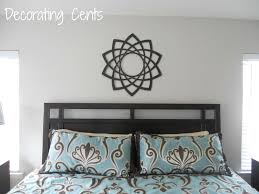 decorating cents the paint s on the wall now that the wall color has changed i definitely need to get on finding new bedding something a little softer you can also see the lamp shades still have