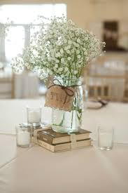 baby s breath centerpiece simple rustic centerpiece using books jar vases