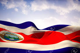 Costa Rico Flag Costa Rica Flag Waving Against Beautiful Blue Sky Stock Photo