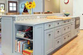 white kitchen cabinets with glass cup pulls learn how to place kitchen cabinet knobs and pulls cliqstudios