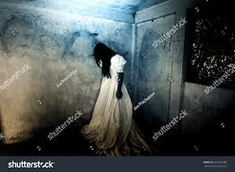halloween ghost and haunted house background alone horror nightghost haunted housemysterious woman stock photo