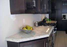 granite countertop designer kitchens with white cabinets