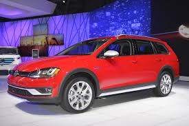 volkswagen red 2017 vw golf alltrack has dual exhaust and red paint like a gti in